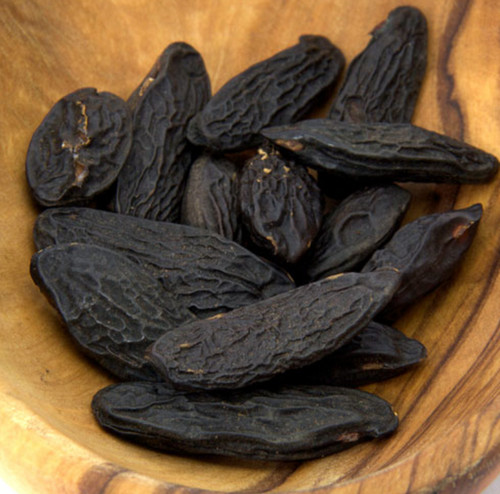 tonka beans, Dipteryx odorata,  They are black and wrinkled and have a smooth, brown interior